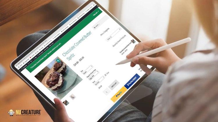Man browsing WordPress and Woocommerce Bakery Website on iPad